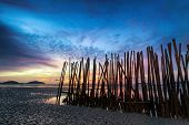 Low tide and bamboo sticks sunrise abstract art photography