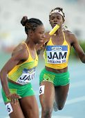 BARCELONA - JULY, 14: O. James(L) and S. Farquharson(R) of Jamaica  competes on 4X400 Relay of the 20th World Junior Athletics Championships at the Olympic Stadium on July 14, 2012 in Barcelona, Spain