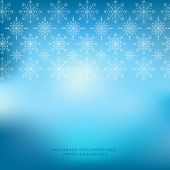 Winter snowflakes ornate blue background.