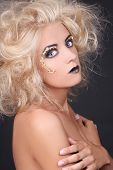 Seductive Woman With Blondie Shaggy Hair And Creative Makeup