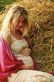 Pregnant Spokeswoman Nature Near Haystack