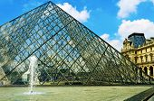 PARIS, FRANCE- MAY 17: The large glass pyramid and the main courtyard of the Louvre Museum on May 17