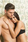stock photo of hot couple  - Sexy passionate heterosexual couple embracing in lingerie - JPG