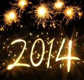stock photo of happy new year 2014  - New Year 2014 made of real light and sparkles - JPG
