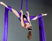 Gymnast performing aerial exercises
