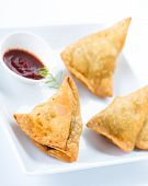 traditional indian snack food samosa with green chutney
