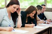 stock photo of frustrated  - Students class have test in classroom - JPG