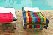 Relax Chairs Near The Pool With Towels
