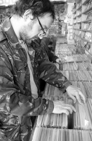 image of lps  - A man flicks through records in a store - JPG