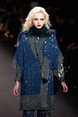 NEW YORK-FEB 12: A model walks the runway at the Anna Sui fashion show during Mercedes-Benz Fashion