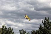 Bright Yellow Firefighter Plane In A Cloudy Sky
