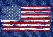 Grunge American flag on jeans background.