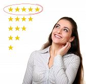 Beautiful Woman Looking Up And Choose Five Stars Rating In Feedback