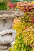 Old Stone Vase In Autumn Park