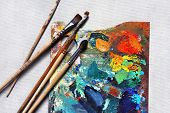 Oil paints picture and paint brushes