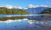 A wonderful summer day in the shallow river. Stony shallows. Chilean Patagonia, the road Carretera Austral