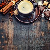 Cup of coffee with sugar, chocolate and spices - Food background