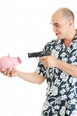 Man with gun pointing at piggy bank isolated on white