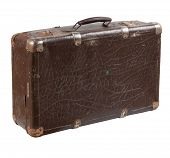 Old shabby leather suitcase with rusty metal brackets on its verges. Photo isolated on white backgro