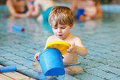 Activities On The Pool, Toddler Boy Swimming, Having Fun And Playing