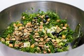 Kale Salad In Silver Salad Bowl On White Background