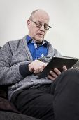 Older man on tablet pc