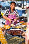 AYUTTHAYA, THAILAND - MAR 11: An unidentified street seller near Ayutthaya Historical Park on Mar 11