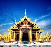 Shwedagon pagoda entrance in Yangon, Rangoon in Myanmar, Burma. Asian travel landmark. Golden Buddhist temple architecture.