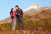 Healthy active lifestyle. Hiker people hiking in beautiful mountain nature landscape. Woman and man