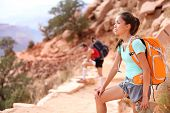 Hiker in Grand Canyon. Hiking woman and man resting tired enjoying hike and view on South Kaibab Tra
