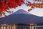 Fuji Mountain on Lake Kawaguchi in the fall season at dusk.