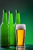 Beer bottles with full glass