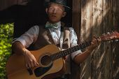 Young Guitarist Plays Acoustic Guitar On Countryside