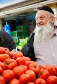 Jerusalem, Israel - November 15, 2012: Elderly Jewish man is shopping for produce at Mahane Yehuda - famous market in Jerusalem