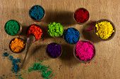 foto of pigments  - Colorful finely powdered Indian pigments in a variety of bright colours - JPG