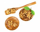 Handful Of Walnuts In Wooden Bowls, Scoop And Green Leaves Isolated.