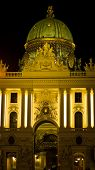 Gate and entrance in front of Hofburg palace at night, Vienna