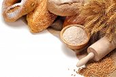 Bread,flour and wheat grains on white background