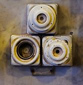 The Old Ceramic Fuses On A Wall