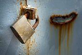 Rusty Padlock On A Door
