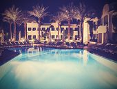 Retro Vintage Stylepicture Of Pool Side Of Hotel At Night.