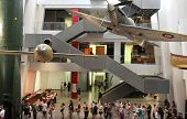 LONDON - AUGUST 1: Visitors viewing exhibits in the atrium of the newly refurbished Imperial War Mus