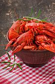 stock photo of crawfish  - Bowl of fresh boiled crawfish on the old wooden background - JPG