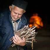 Elderly, Poor Man Carrying Firewood