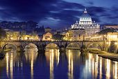 Night Image Of St. Peter's Basilica, Ponte Sant Angelo And Tiber River In Rome - Italy.