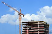 Construction site. Crane and building under construction.