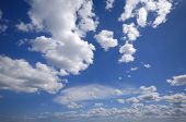 White cumulus clouds and blue sky