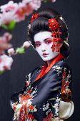 young pretty geisha in kimono