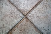 X Formed By Floor Tiles