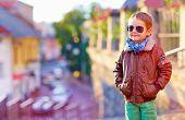 picture of bomber jacket  - stylish kid walking city street autumn fashion - JPG